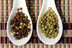Green and color pepper Stock Photos