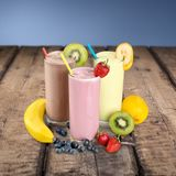 Colorful healthy milkshakes isolated on. Green color red background colorful isolated summer stock images