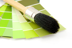 Green color samples and paint brush Royalty Free Stock Photos
