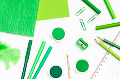Green color school supplies Royalty Free Stock Photography