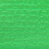 Green color textile background from stitched silk Stock Image