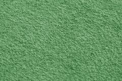 Green color towel surface close-up with blur effect. Stock Image