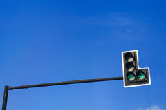 Green color on the traffic light with a beautiful blue sky in ba Royalty Free Stock Images