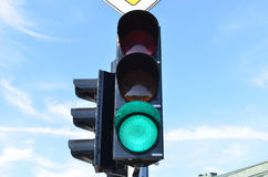 Green color traffic light blue sky in background. Green color on traffic light with beautiful blue sky in background Royalty Free Stock Photography