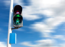 Green color on the traffic light for pedestrian. Stock Photo