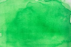 Green watercolor on paper painted background texture. Green color watercolor on paper painted background texture stock illustration