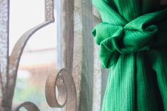 Green color window curtain Royalty Free Stock Images