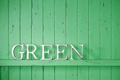 Green Color Word Background. A green painted wood background with the word green Stock Photography