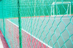 Green colored chain link fencing. Surrounding futsal court royalty free stock photos