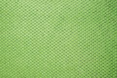 Green colored fabric swatch samples texture unprinted suiting fabric from above .Cloth texture stock image