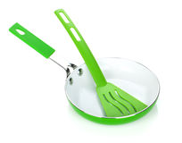 Green colored frying pan and utensil Stock Photo