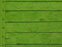 Green colored old wood plank with rivets Royalty Free Stock Photo
