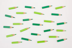 Green colored pencils pointing in the same direction. Crowd of green colored pencils pointing in the same direction - abstract image visualizing leadership Stock Image