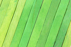 Green colored popsicle sticks background. This is a photograph of Green colored popsicle sticks background royalty free stock photo