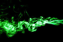 Green colored smoke on a black background. Beautiful background Royalty Free Stock Photos