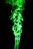 Green colored smoke on a black background. Beautiful background Royalty Free Stock Photography