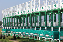Green colored start gates for horse races on the racetrack Royalty Free Stock Images