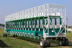 Green colored start gates for horse races on the racetrack Royalty Free Stock Image