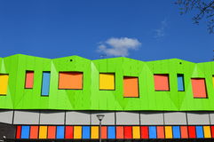 Green coloured modern building Stock Photos