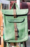 Green leather backpack in the bright midday sun Royalty Free Stock Photos