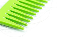 Green comb with hair Stock Image