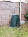 A green compost bin outside in garden Royalty Free Stock Images
