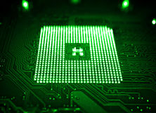 Green computer motherboard and processor slot with blur effect macro high contrasted Stock Images