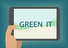 Green IT concept with hand holding smart phone Stock Image