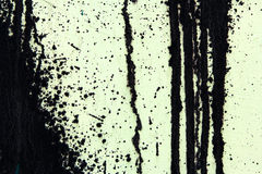 Green concrete wall with black paint drips, abstract background Stock Photography