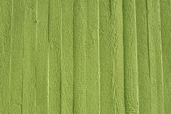 Green concrete wall with wooden structure. Green concrete wall with small wooden structure. Rough sawn form-work royalty free stock images
