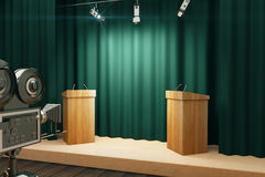 Green conference hall with tribune and vintage camera Stock Photo