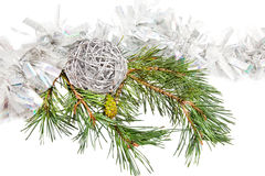 Green conifer branch with silver ball and tinsel. Isolated on white stock photos