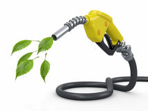 Green conservation. Gas pump nozzle and leaf Royalty Free Stock Image