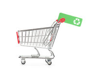 Green consumerism. (bio, eco, recycling etc.) concept - shopping cart with green label with recycling sign royalty free stock photo