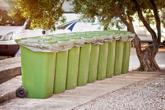 Green containers collectiong trash at camp Royalty Free Stock Image