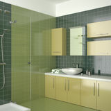 Green contemporary bathroom with yellow furniture.  Stock Images