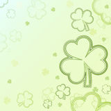 Green contours of shamrocks over light background Stock Image
