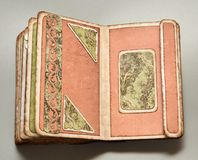 Green and coralline pages of old-looking handmade photo album. Two green and coralline pages of old-looking handmade photo album with floral pattern paper Royalty Free Stock Image