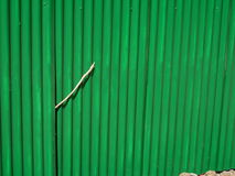 Green Corrugated Fencing. Showing a repair Royalty Free Stock Photos