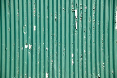 Green corrugated iron fencing. Distressed corroded, green corrugated iron fencing Royalty Free Stock Photos