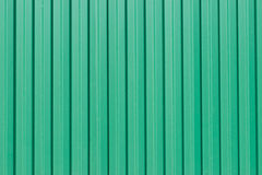 The green corrugated metal walls, background Royalty Free Stock Photo