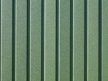 Green corrugated steel sheet with vertical guides. Royalty Free Stock Photography