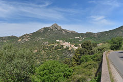 Green Corsican mountain with a small village Pigna Royalty Free Stock Photography