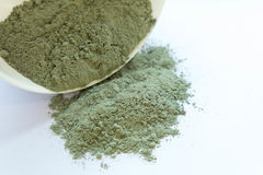 Green cosmetic clay powder. natural clay mask for face and body. Green cosmetic clay texture close up. solution of Royalty Free Stock Photos