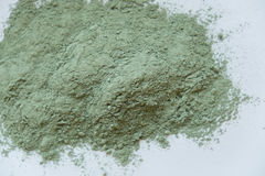 Green cosmetic clay powder. natural clay mask for face and body. Green cosmetic clay texture close up. solution of Royalty Free Stock Images