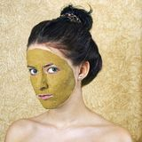 Green cosmetic mask on girl face Stock Images