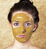 Green cosmetic mask on girl face Royalty Free Stock Photos