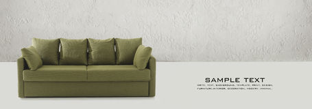 Green couch on business card Royalty Free Stock Images