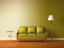 Green couch with table and standard lamp Royalty Free Stock Images