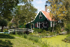 Green Country Side House. Dutch Calm and Quiet Country side house bordered by green water canal Royalty Free Stock Images